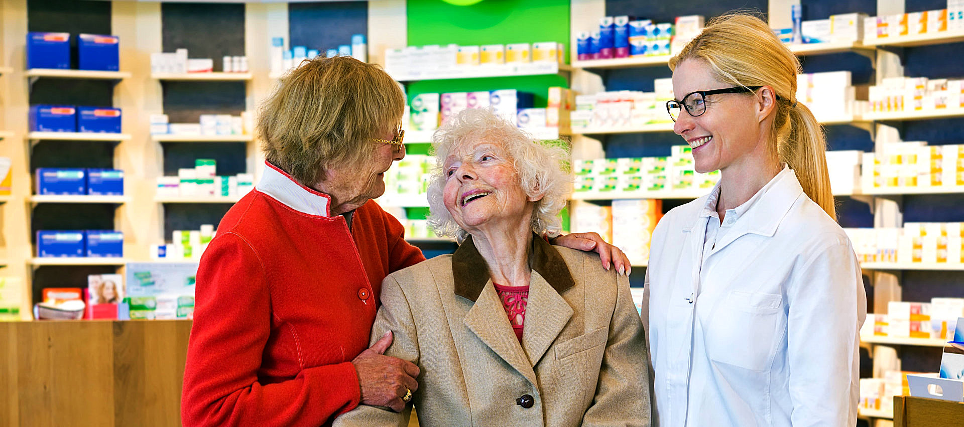 elder woman with a friend on a pharmacy