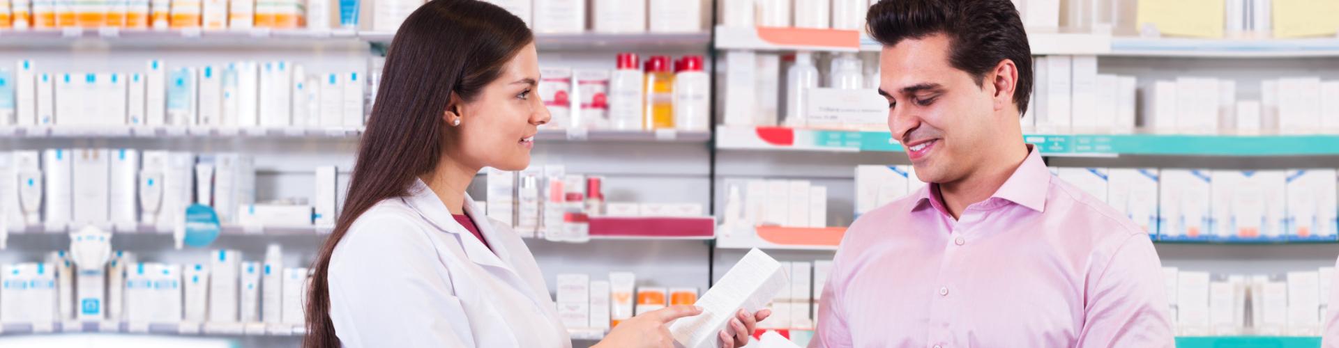 pharmacists showing product to customer