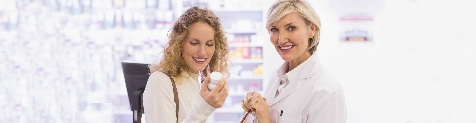 pharmacist and woman in a pharmacy